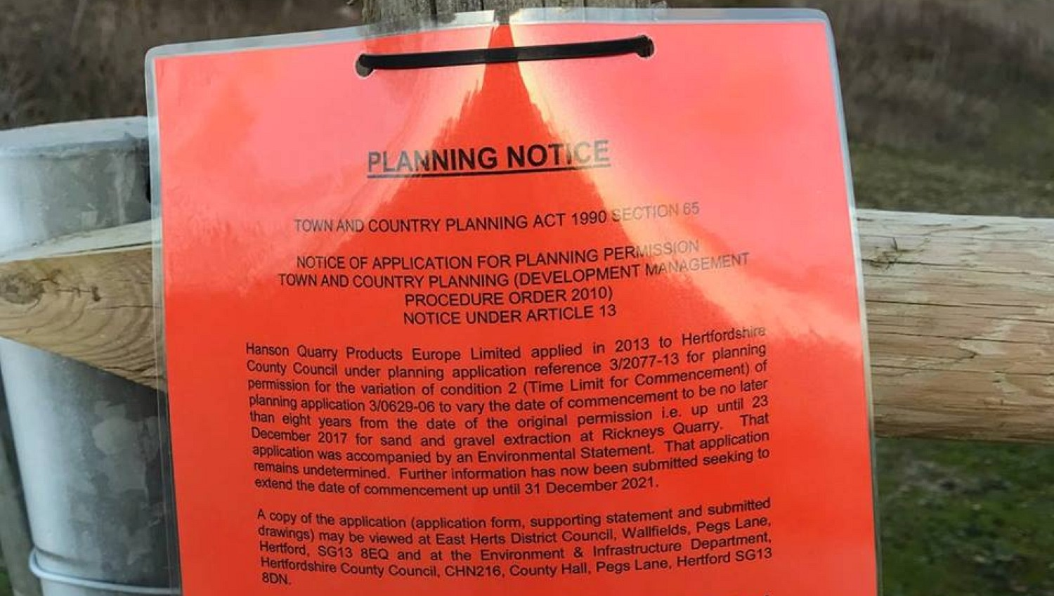 Laminated notice attached to wooden post